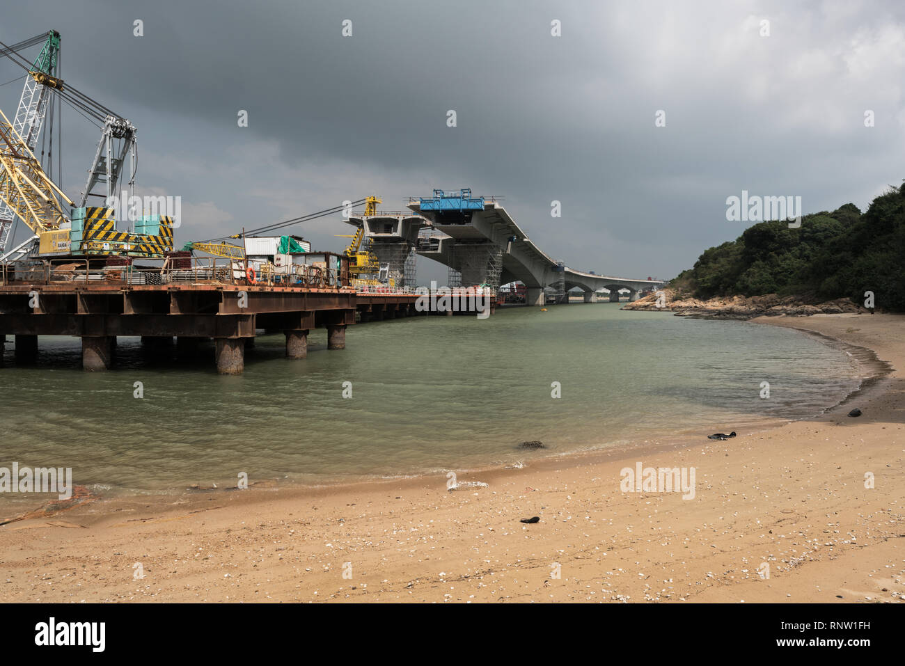 Hong Kong, Zhuhai, Macau Bridge under construction on the Sha Lo Wan Beach near Tung Chung in the Hong Kong New Territories. - Stock Image