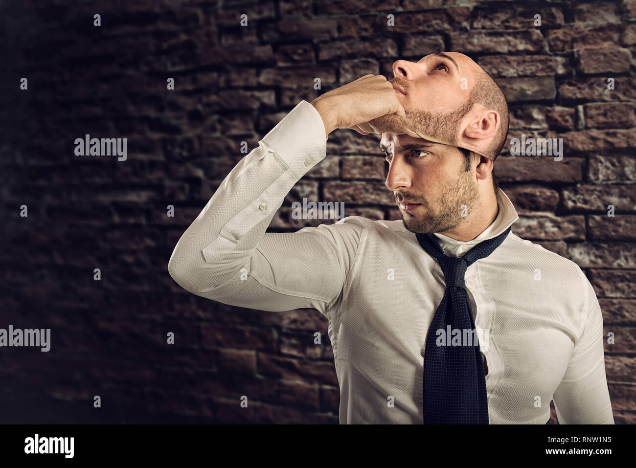 Businessman with multiple personality changes the mask Stock Photo