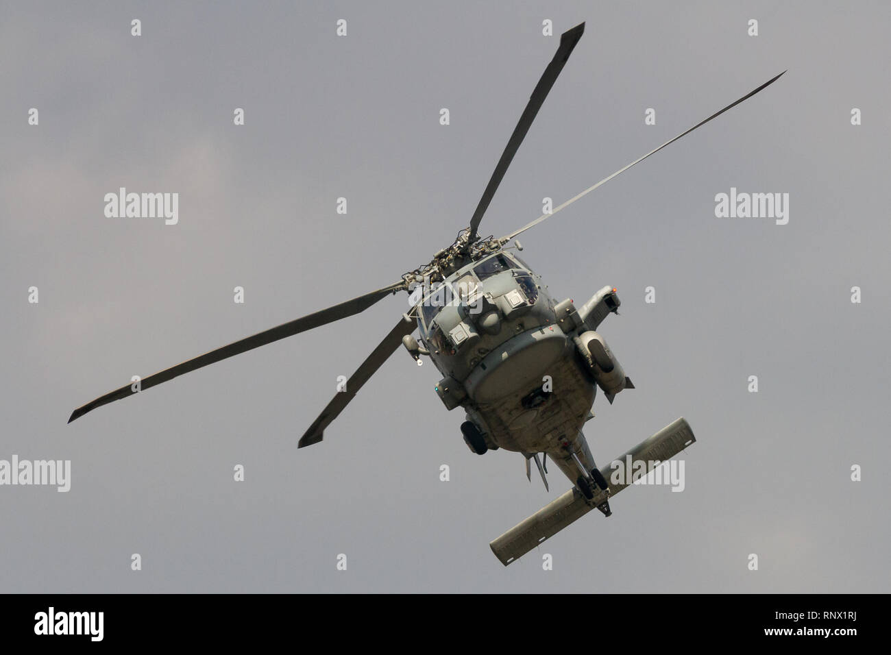 A Sikorsky MH-60R Seahawk helicopter with the Helicopter Maritime Strike Squadron (HSM-51, known as the War Lords flying out of Naval Air Facility Ats Stock Photo
