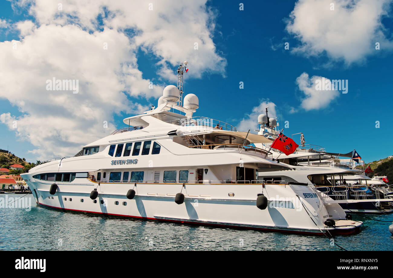 Gustavia, st.barts - January 25, 2016: yachting, luxury travel on yacht. Yachts anchored at sea pier on tropical beach. Summer vacation on island wanderlust. Water transport and vessel. - Stock Image