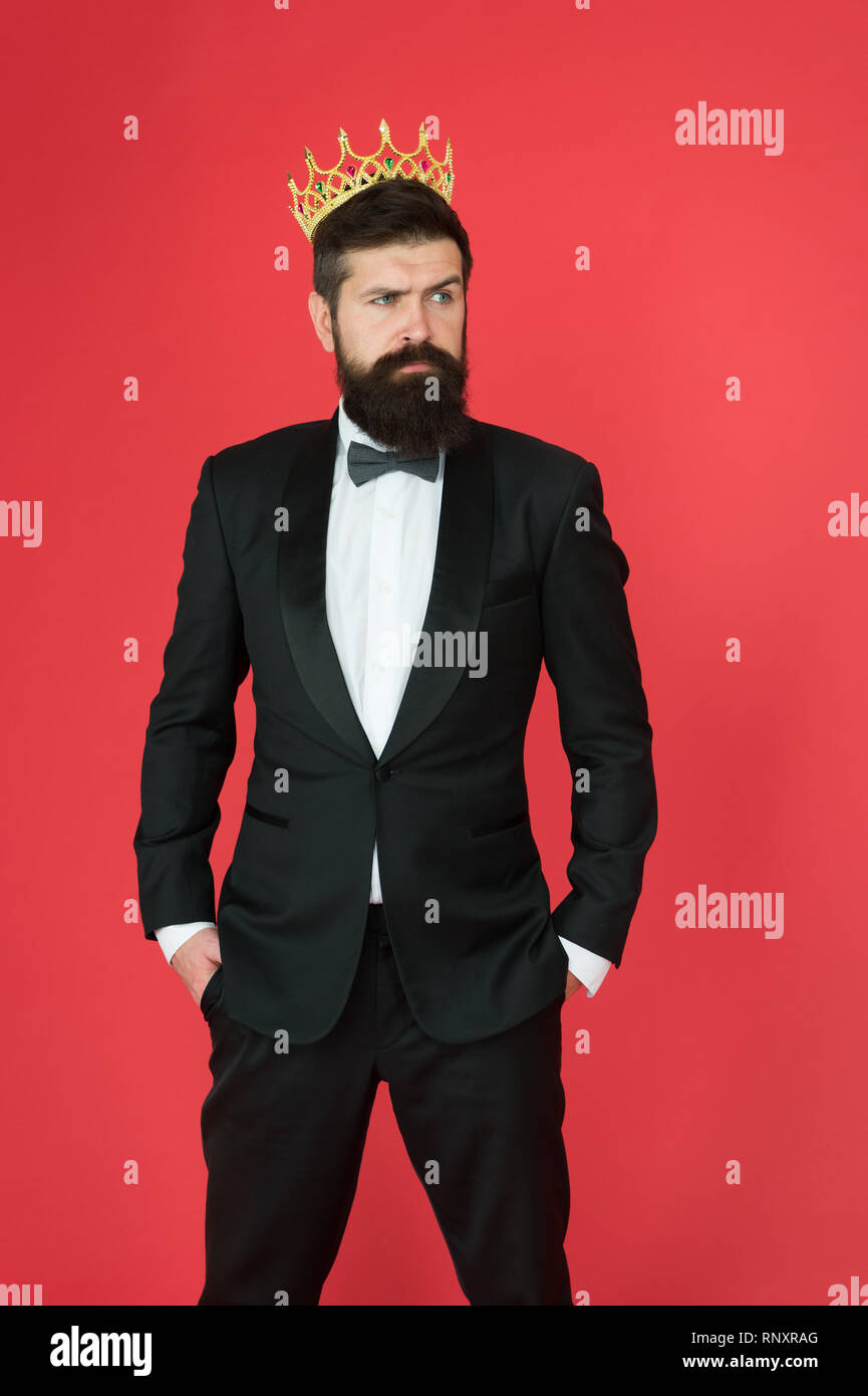 Narcissistic king. Man bearded guy in tuxedo golden crown symbol of monarchy. King ceremony. King attribute. Feeling superior. Self confidence concept. Handsome hipster formal suit. Elite society. - Stock Image