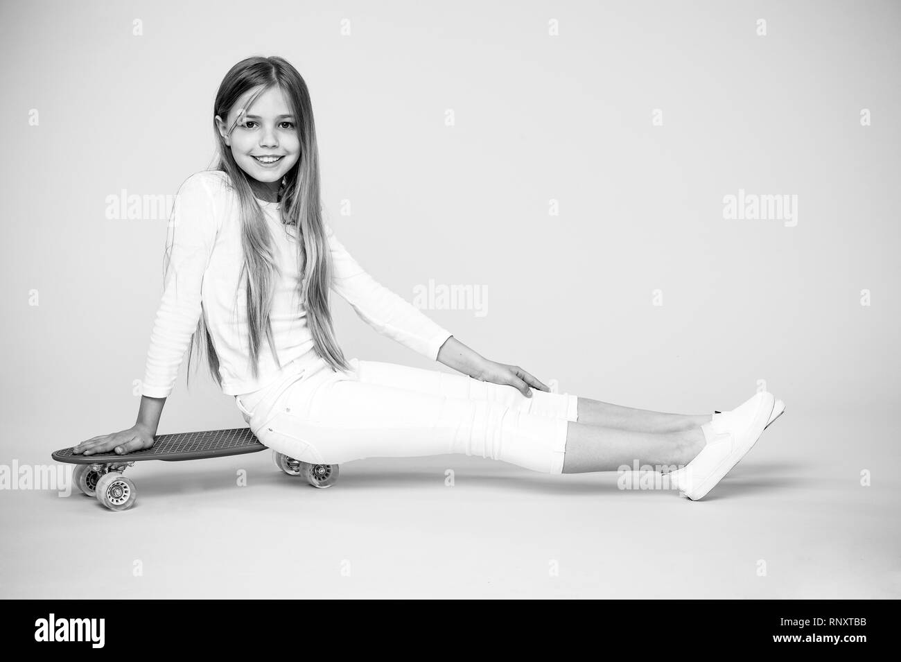 35c123b3b0ea Little girl sit on penny board. Happy little skater. Little hipster enjoy  skateboarding.