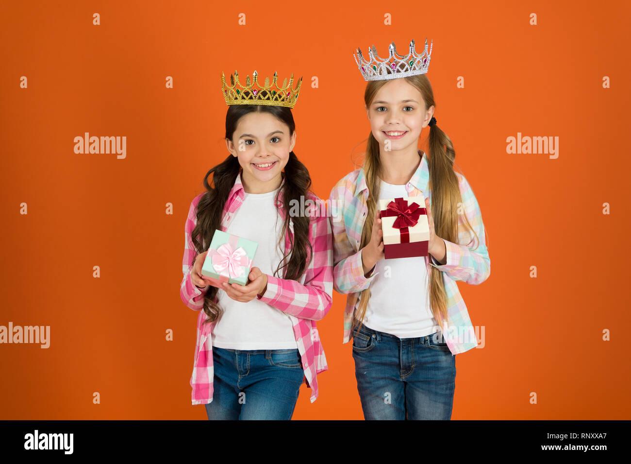 Egocentric princess. Kids wear golden crowns symbol princess. Every girl dreaming become princess. Little princess. Happy childhood. We deserve only best. Girls wear crowns. Spoiled children concept. - Stock Image