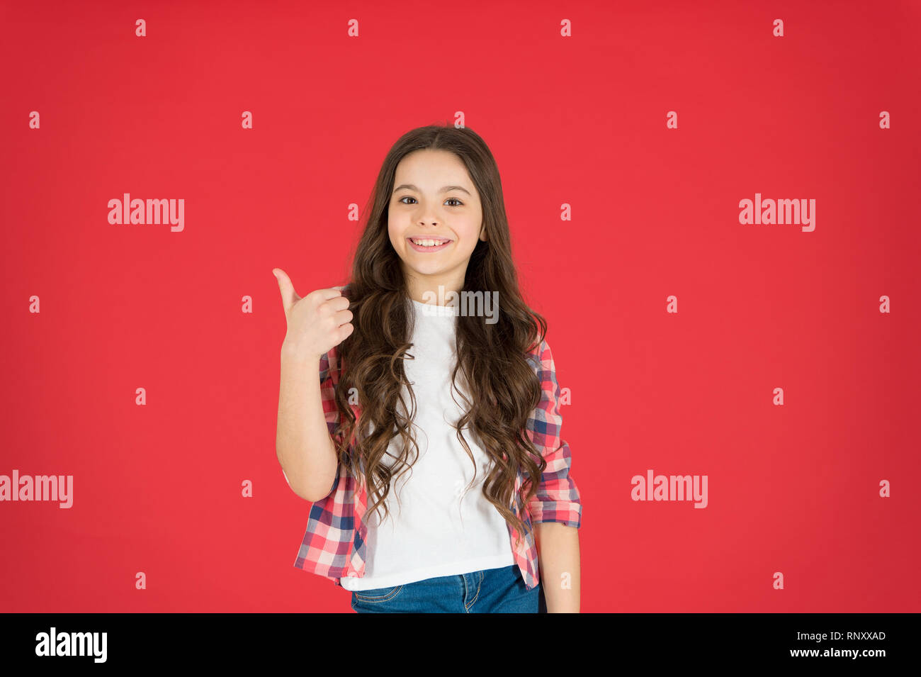 Recommend something. This is awesome. Girl cute child show thumbs up gesture. Teens totally love. Kid show thumbs up. Girl happy totally in love fond of or highly recommend. Thumbs up approvement. - Stock Image