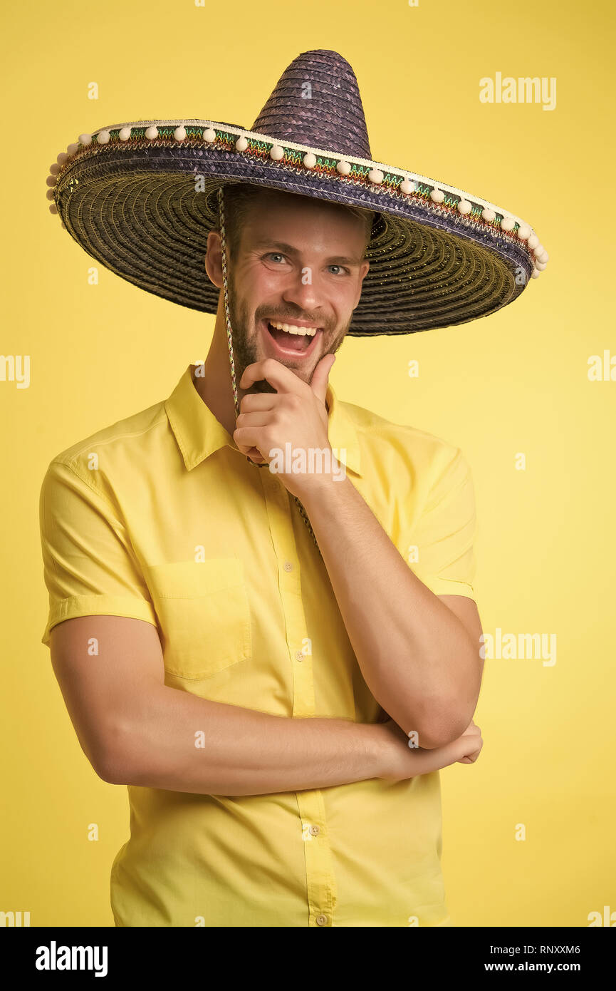 c25d1891b25 Happy guy smile in sombrero hat. Male fashion. Always in good mood. Mexican  style. Mexico. Traditional clothes. theme party. Handsome and stylish man.