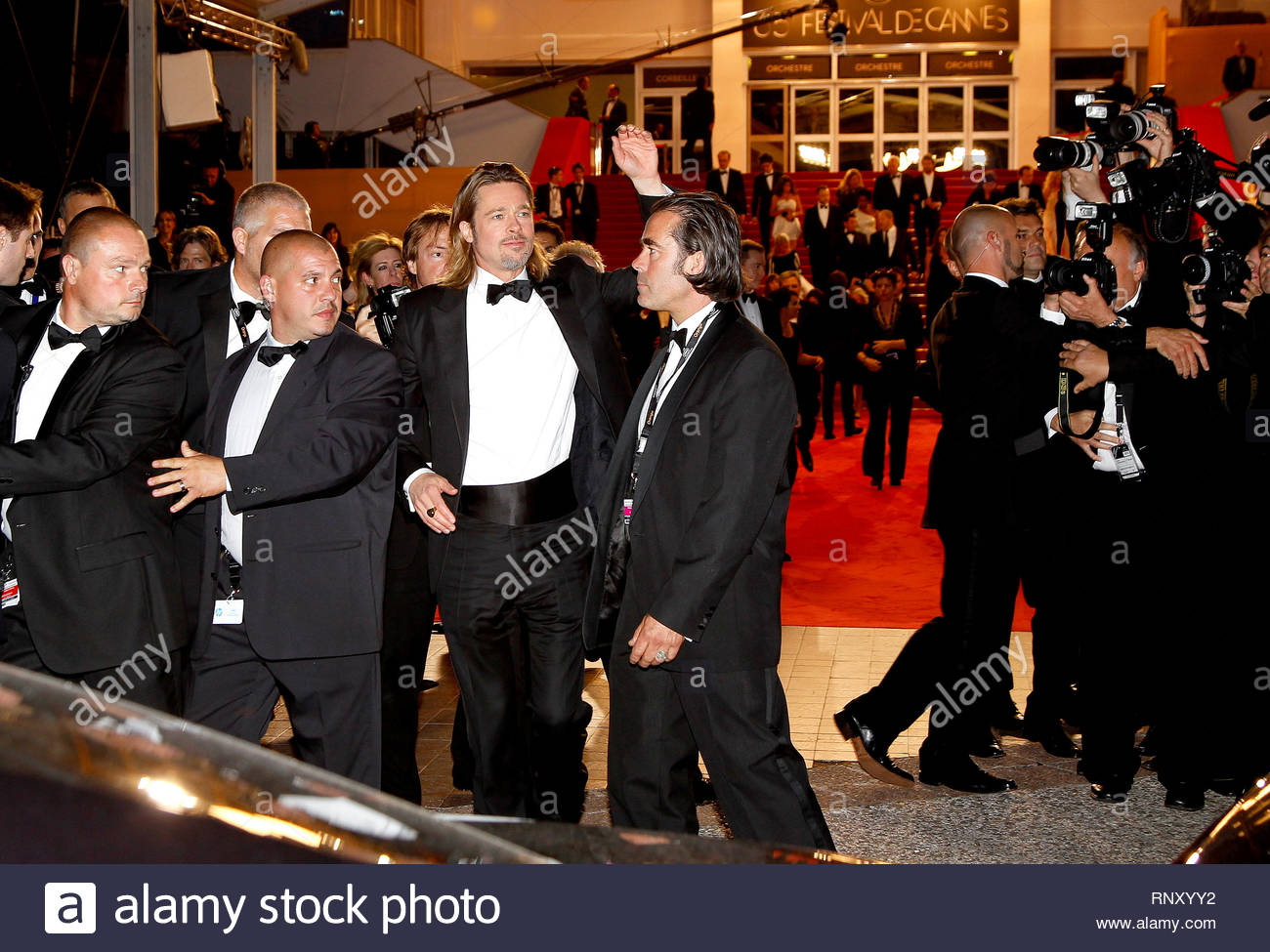 [USA ONLY] Cannes, France - Actor Brad Pitt waves to his fans after attending the premiere of ...