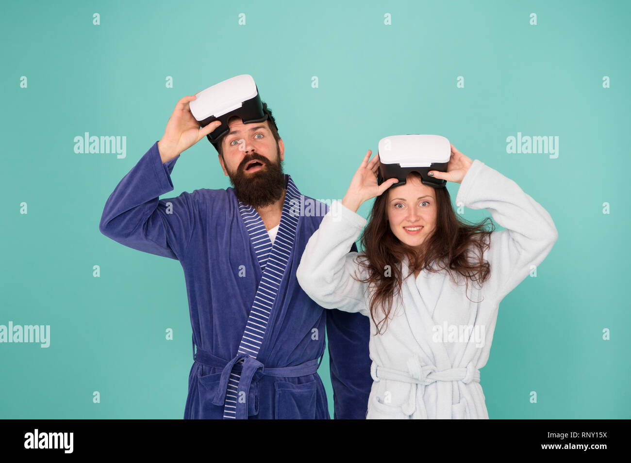 e47d2ce58263 Happy family in vr glasses. Good morning. Virtual reality. Love. Couple in  love. Family. Bearded man and woman in robe pajama. it it so real. future  is now. ...