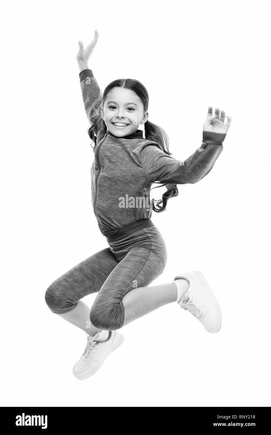 Deal with long hair while exercising. Girl cute kid with long ponytails sportive costume jump isolated on white. Working out with long hair. Sport for girls. Guidance on working out with long hair. - Stock Image