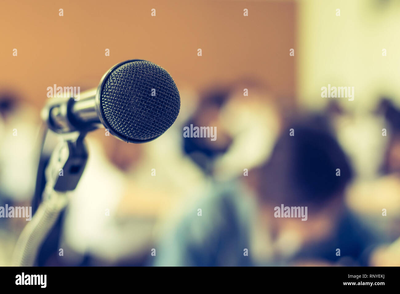 Microphone voice speaker with audiences or students in seminar classroom, lecture hall or conference meeting in educational business event for host, t - Stock Image