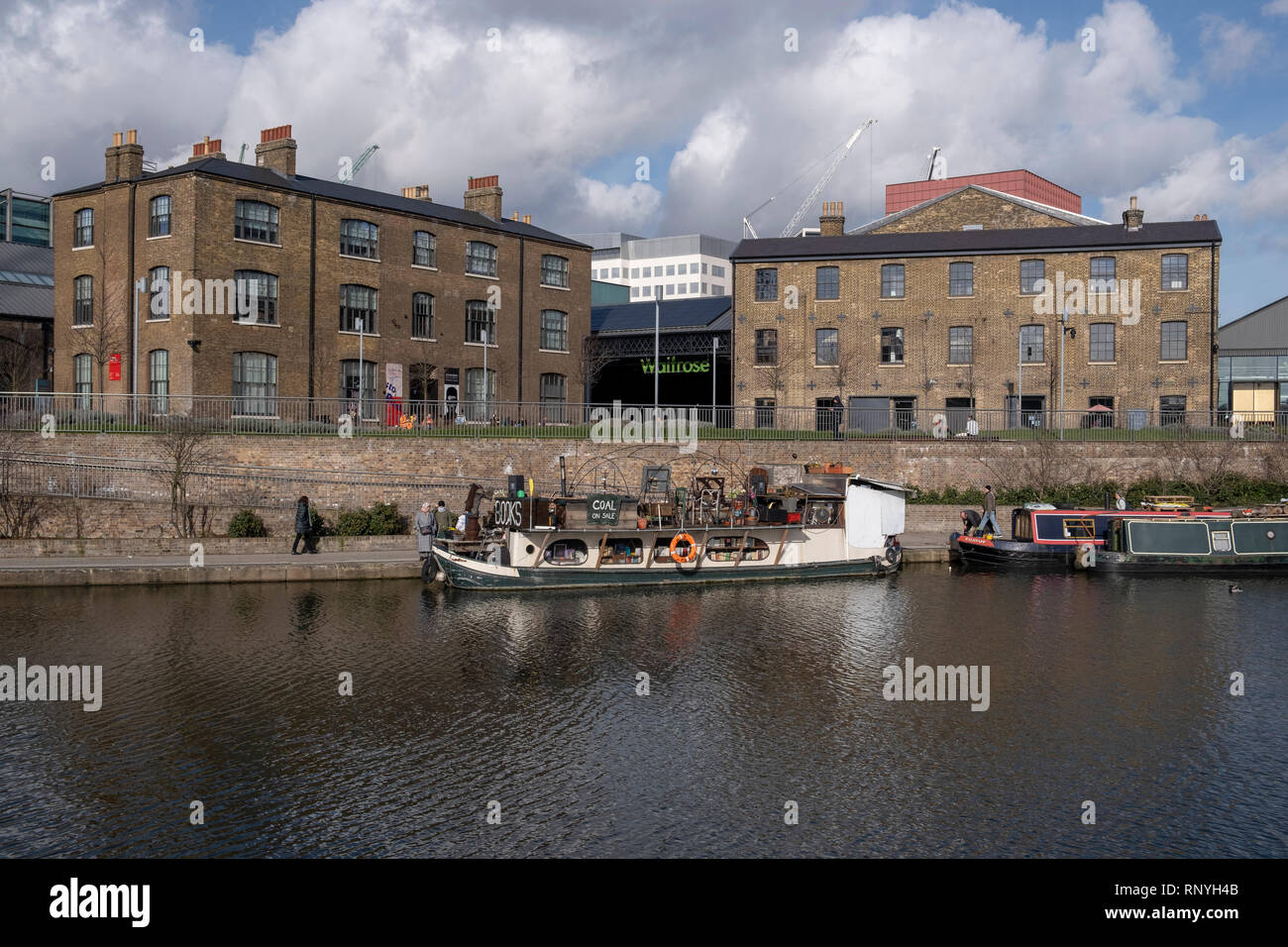 Refurbished railway buildings in the Kings Cross Goodsyard part of the Kings Cross redevelopment next to the Regents Canal near Islington - Stock Image