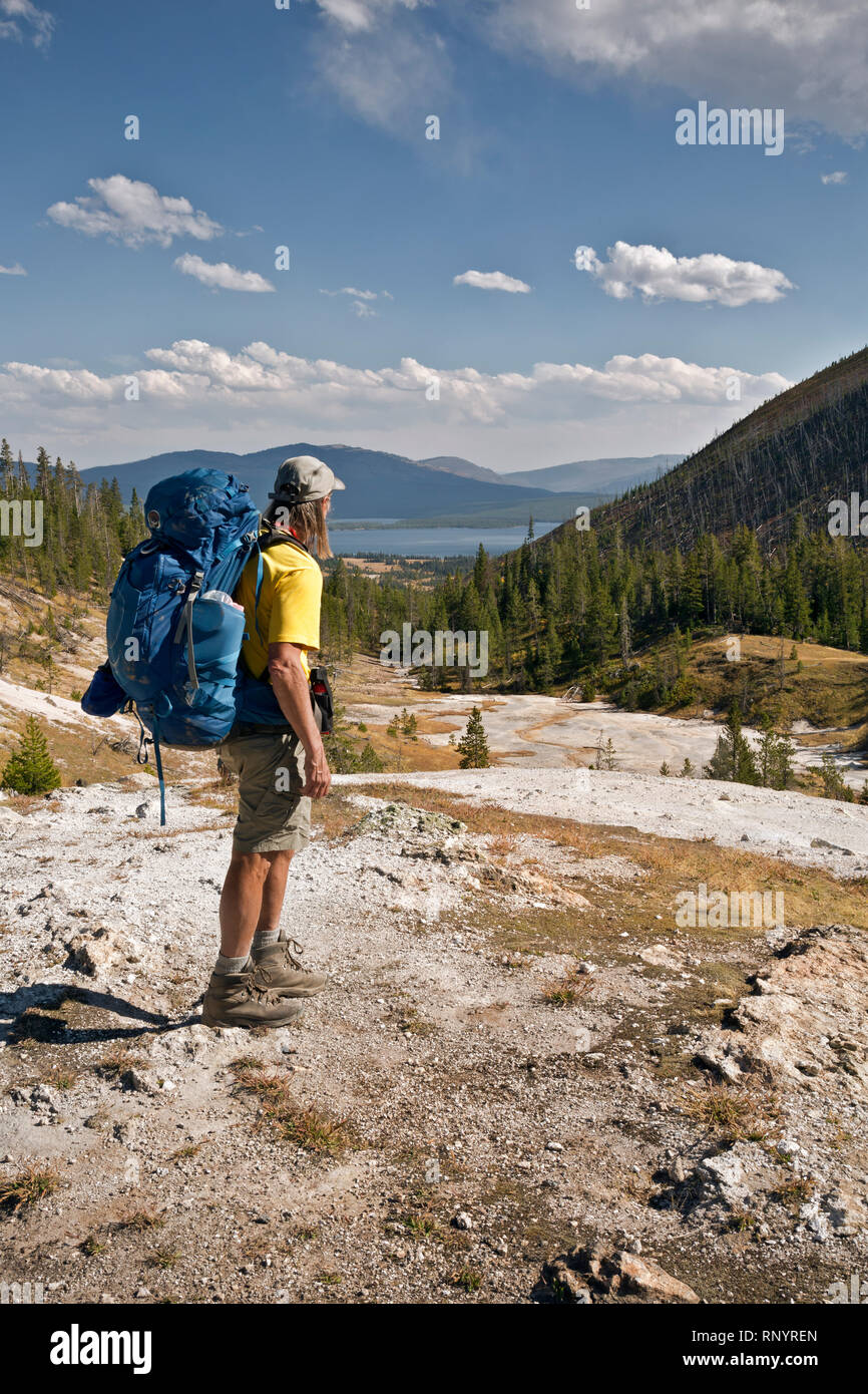 WY03816-00...WYOMING - Hiker at the Upper thermal area along the trail to Heart Lake and the Heart Lake Geyser Basin in Yellowstone National Park. - Stock Image