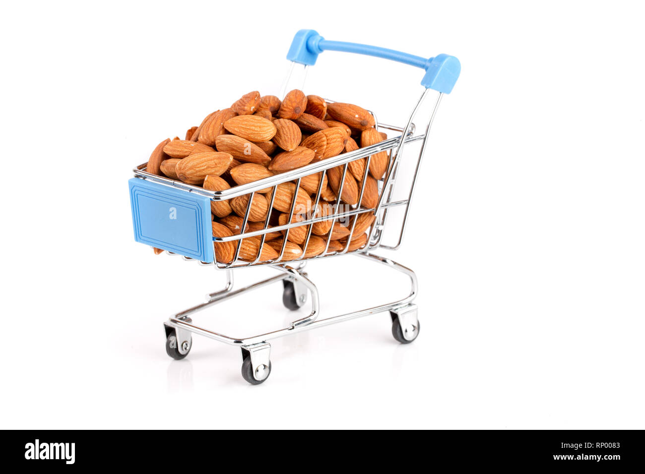 Shopping cart with raw almond isolated on white background Stock Photo