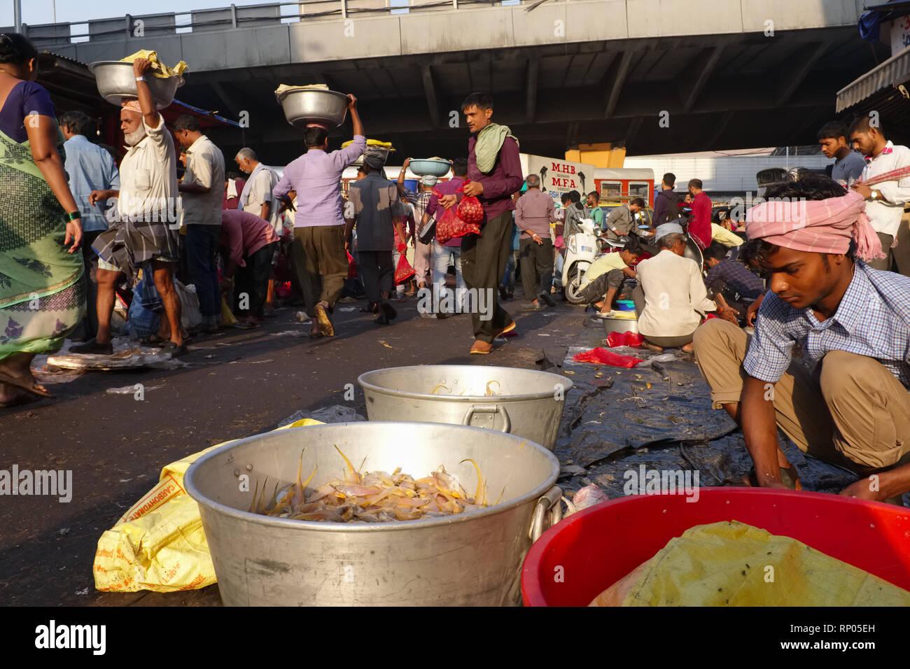 Porters and market activity in a fish market near Crawford Market or Mahatma Jyotirao Phule Market, in Mumbai, India - Stock Image