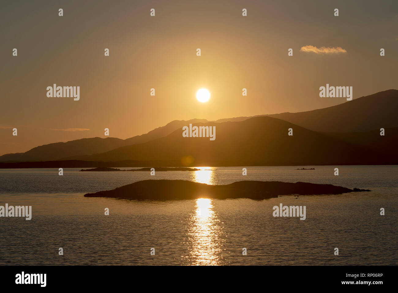 Sunrise over Loch Bee/ Loch Bi, the popular fishing inland loch with views behind of the hills of South Uist, Outer Hebrides, Scotland, UK - Stock Image