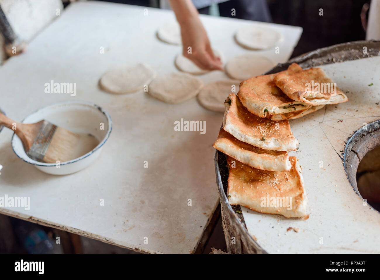 Freshly baked turnovers with scallion - Stock Image