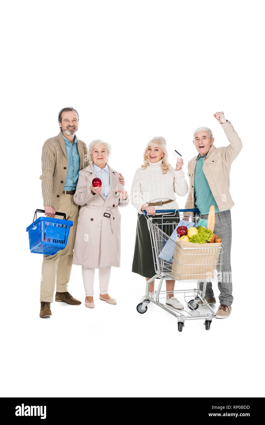 happy  senior people standing near retired woman with credit card isolated on white - Stock Image