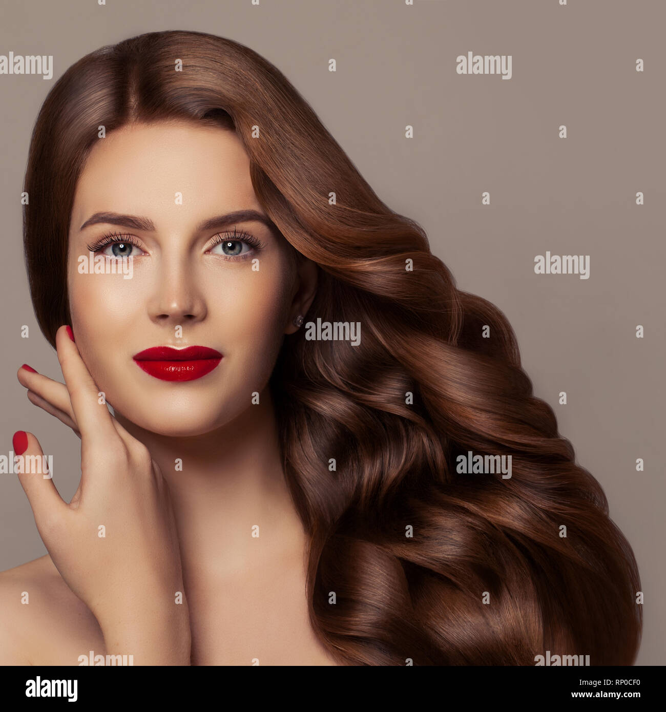 Redhead woman face. Stylish model girl with ginger curly hair. Hair care concept - Stock Image
