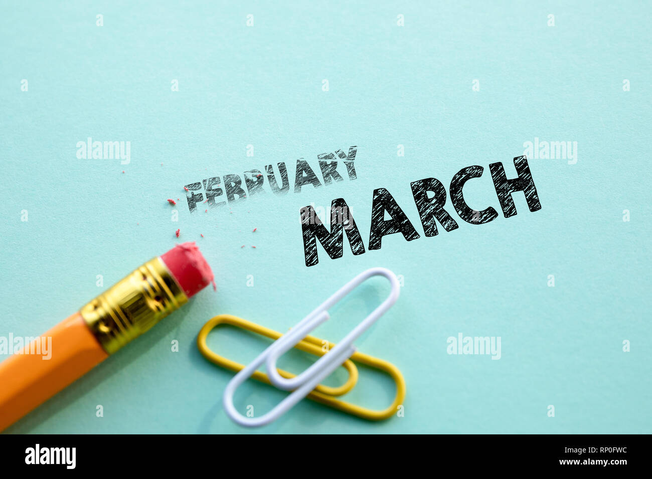 Making February in to March by eraser. Concept for action and reaching goals - Stock Image