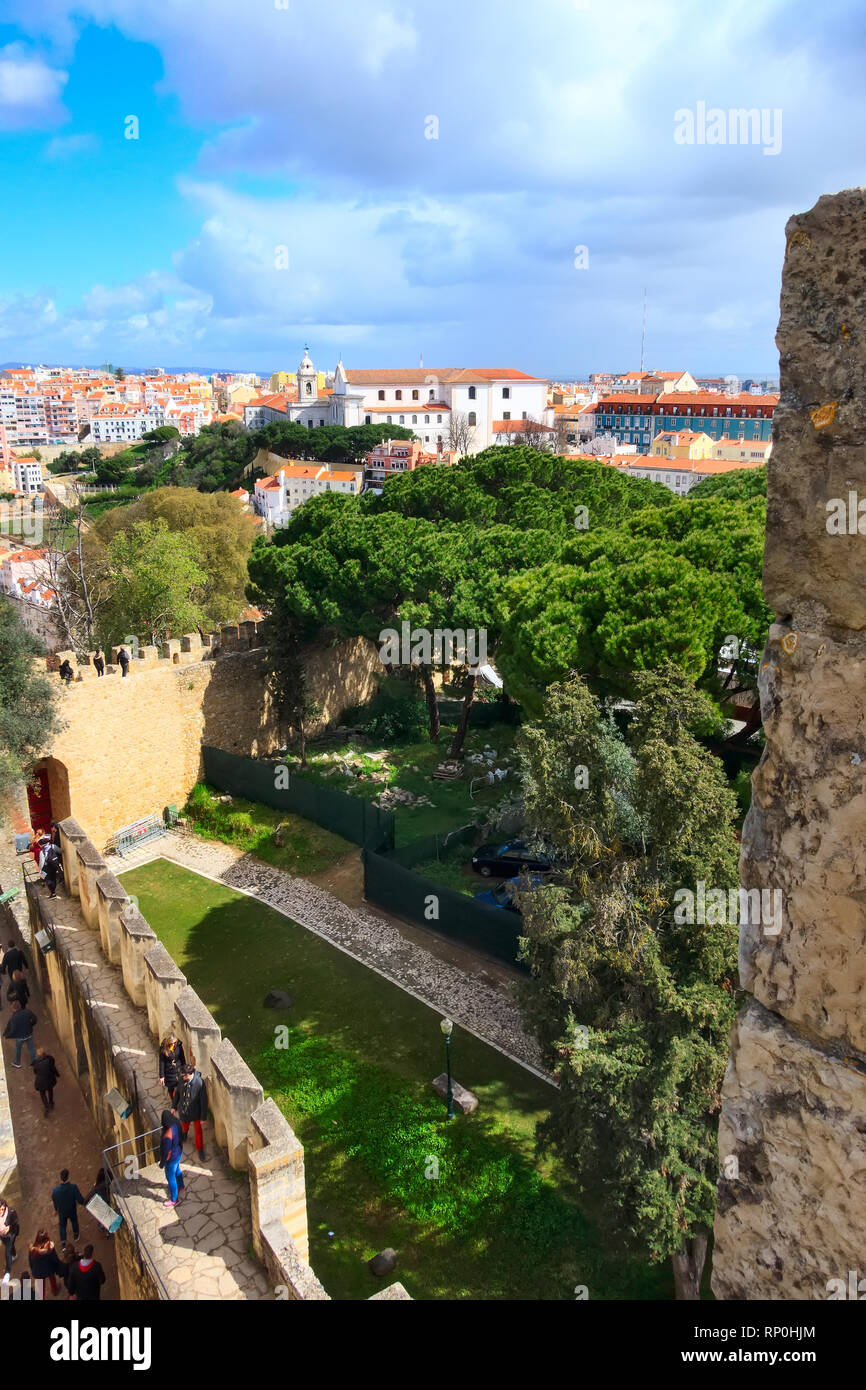 Lisbon, Portugal - March 30, 2018: People at Saint George Castle and city panorama with colorful houses - Stock Image