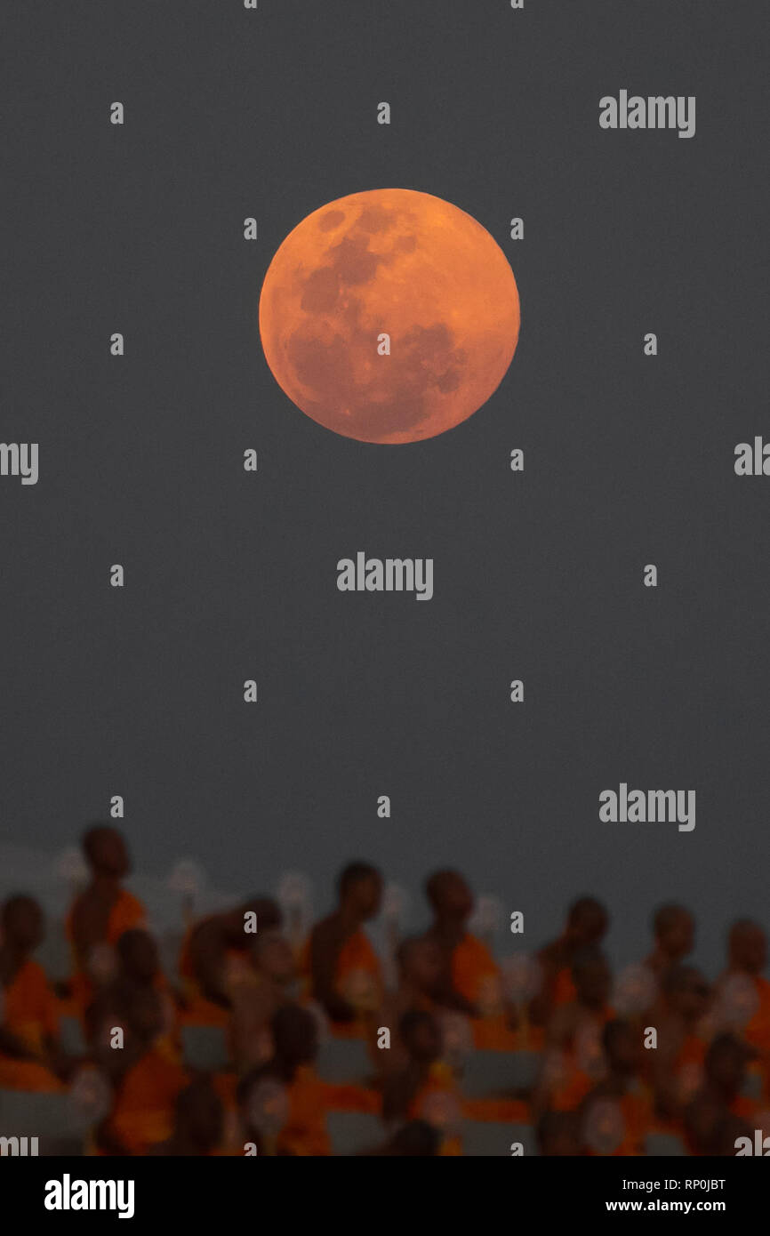 Buddhist Monks Pray As Super Full Moon Is Seen During A Ceremony To