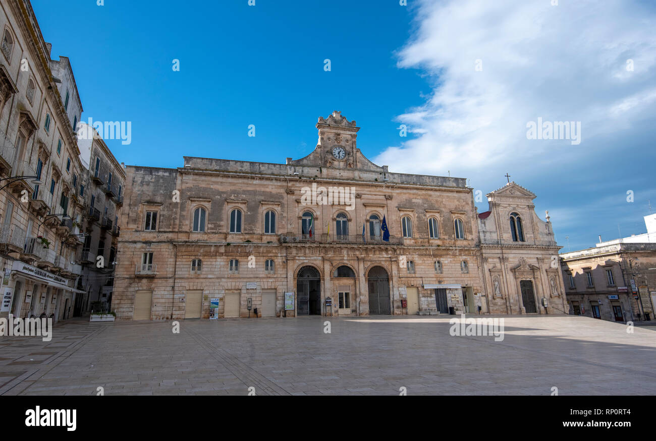 Main square with city hall in the center of Ostuni, Apulia, Puglia, Italy. Piazza della Liberta and Church Chiesa di San Francesco D'Assisi cathedral - Stock Image