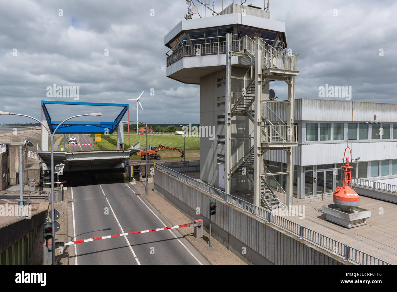 Flood barrier of the Eider River avoiding the North Sea flooding the inland marshes, Wesselburenkoog, Dithmarschen, Schleswig-Holstein, Germany - Stock Image