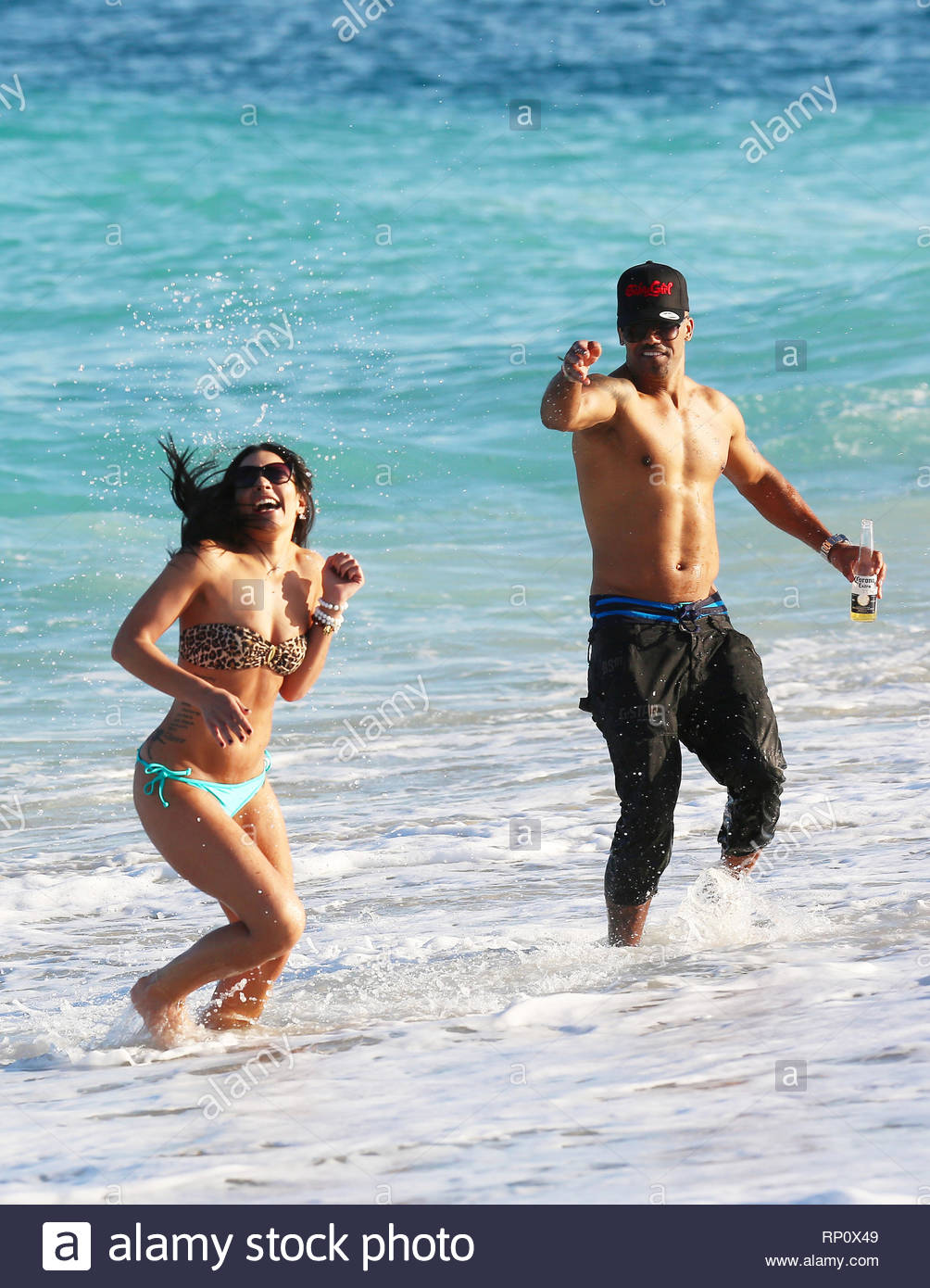 Miami, FL - Shemar Moore showed off his fit body in South Beach Miami today  with a hot brunette babe, Shemar enjoyed a cold beer and posed with a  little boy ...