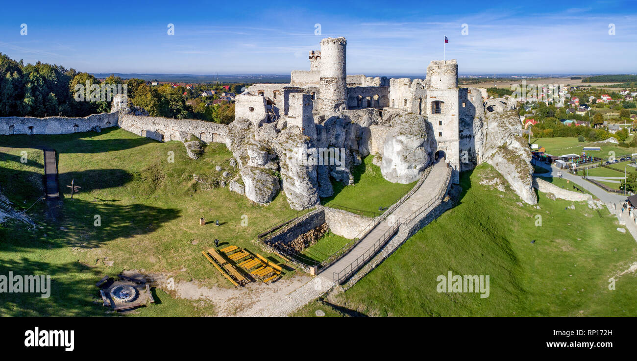 Wide panorama of the ruins of medieval castle on the rock in Ogrodzieniec, Poland. One of strongholds  called Eagles Nests in Polish Jurassic Highland Stock Photo