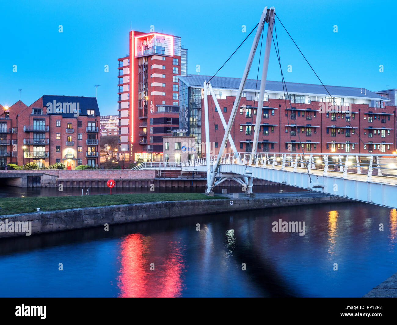 Knights Way Bridge over the River Aire at Leeds Dock at dusk Leeds West Yorkshire England - Stock Image