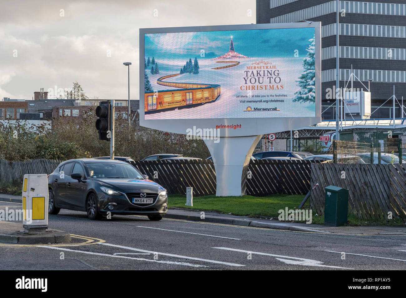 electronic adverts on street signs. - Stock Image