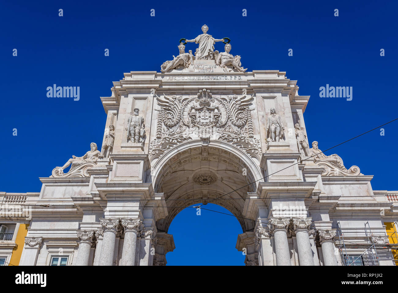 Rua Augusta Arch - Arco da Rua Augusta with statues of Glory rewarding Valor and Genius at Commerce Square - Praca do Comercio in Lisbon, Portugal - Stock Image