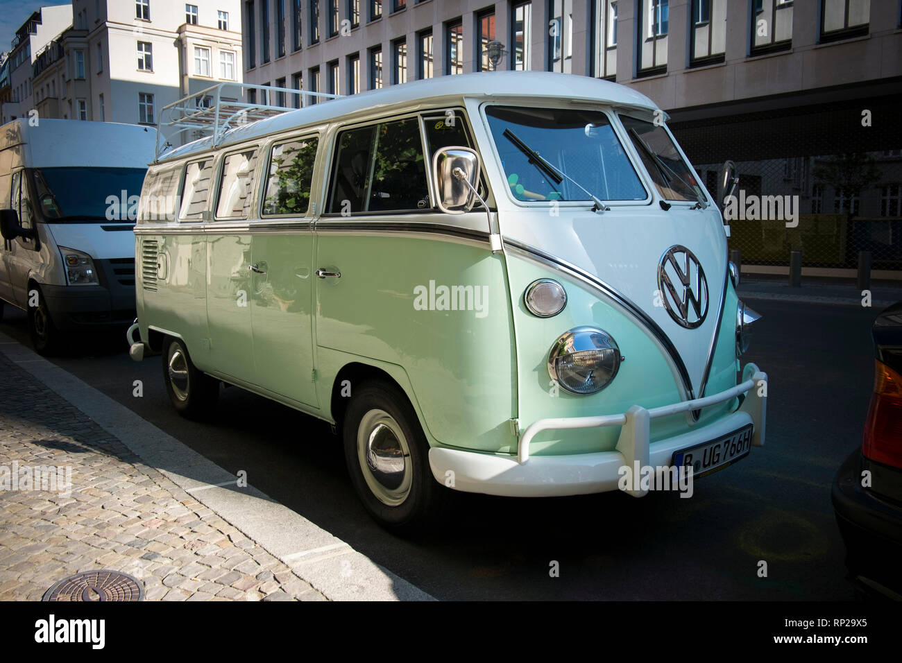 A classic Volkeswagen Minibus parked on the street in Berlin, Germany. - Stock Image