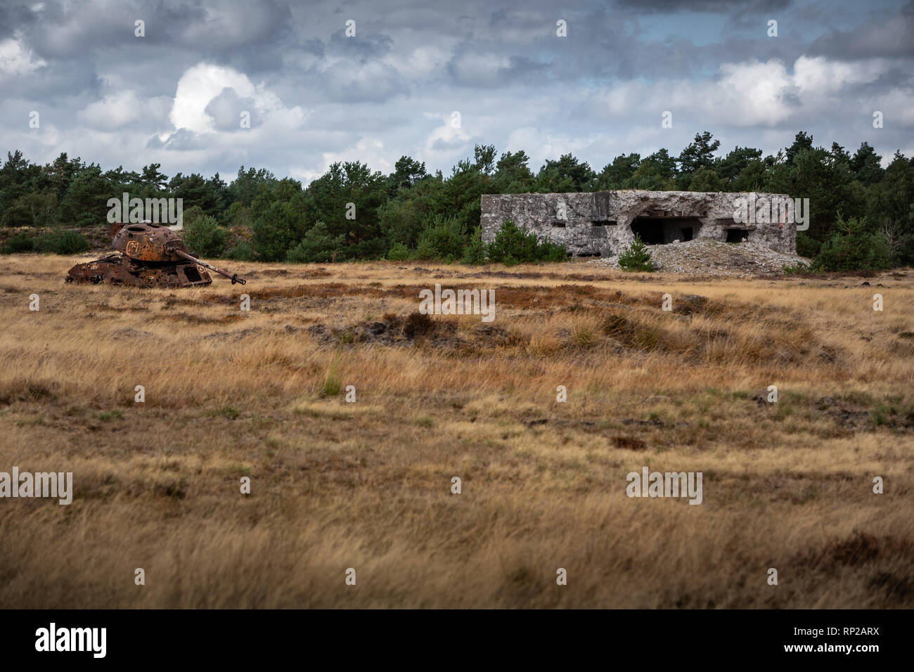 Discarded tank and bunker at the Bundeswehr firing range and military training area of the at the military training area Senne in Hšvelhof, which is still operated by the British Army. - Stock Image