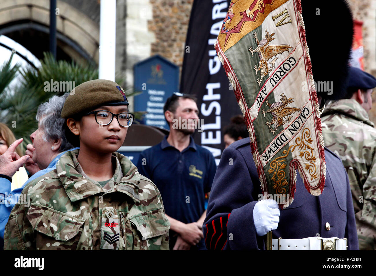 Cardiff, Wales, UK. February 20th 2019. A young army cadet stood outside Cardiff Castle at the 1st Battalion Welsh Guard's homecoming parade. This Batallion had just served their third tour in Afghanistan. Credit: Lily Watts/Alamy Live News - Stock Image