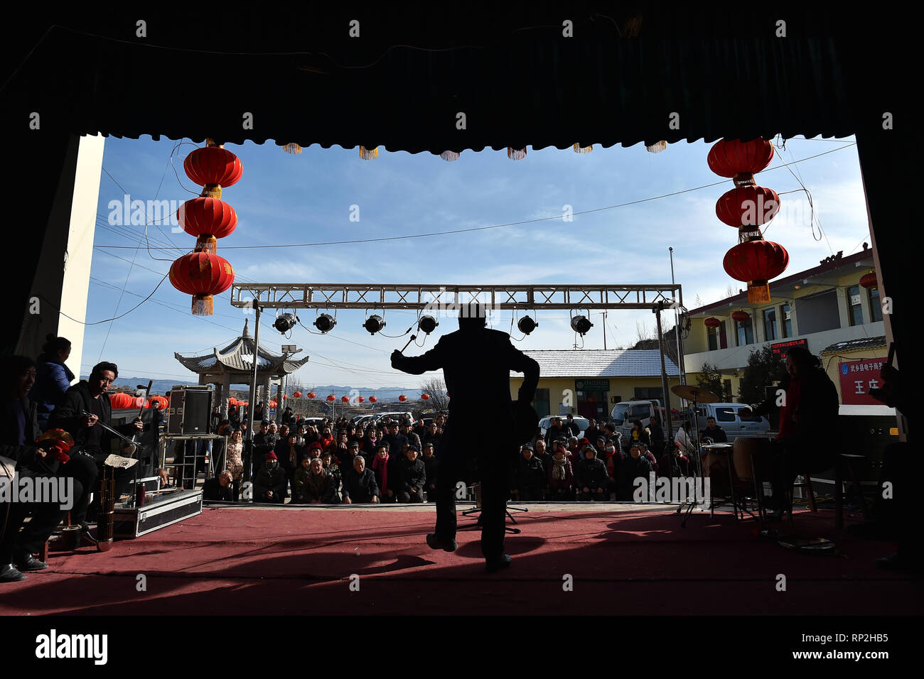 (190220) -- WUXIANG, Feb. 20, 2019 (Xinhua) -- A troupe performs for villagers at an open-air theater in Wangzhuanggou Village, Wuxiang County of north China's Shanxi Province, Feb. 16, 2019. For generations, residents of Wangzhuanggou Village barely scraped a living as a result of geographical isolation. However, a great change has been made since a series of poverty relief programs were launched in 2014. The whole village has been lifted out of poverty by the year of 2018 with the per capita annual income rising to 6,100 yuan (907 U.S. dollars) that enables villagers to spend on an grand cel - Stock Image