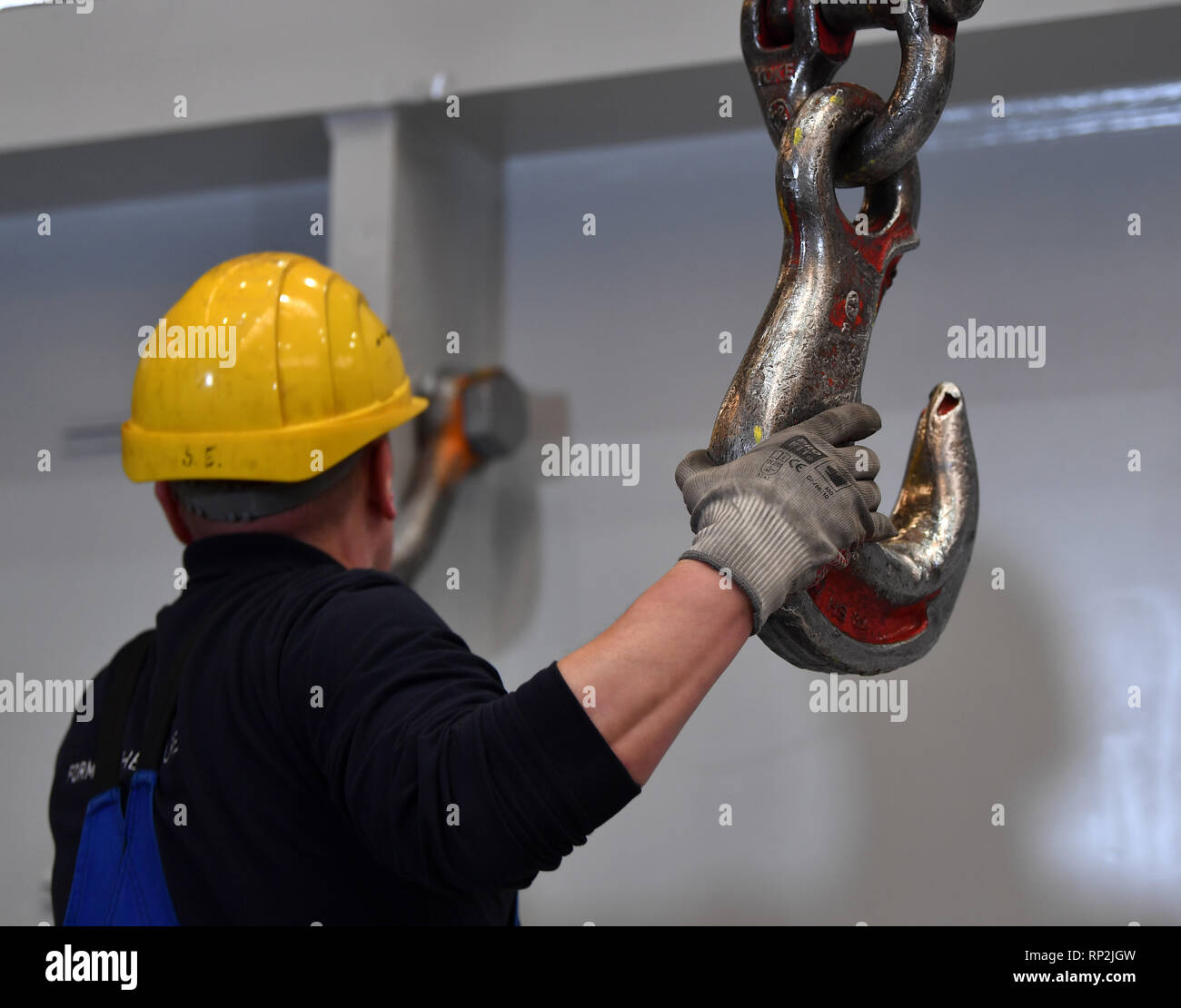 Erfurt, Germany  20th Feb, 2019  An employee attaches the component