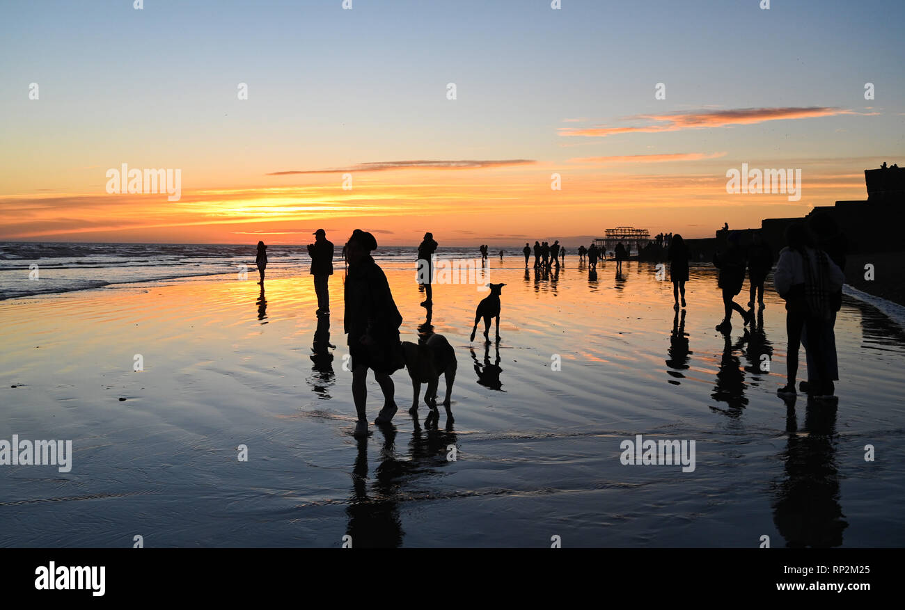 Brighton, UK. 20th Feb, 2019. Visitors enjoy a beautiful sunset on Brighton beach as sunny weather is forecast to continue in the south over the next few days Credit: Simon Dack/Alamy Live News Stock Photo
