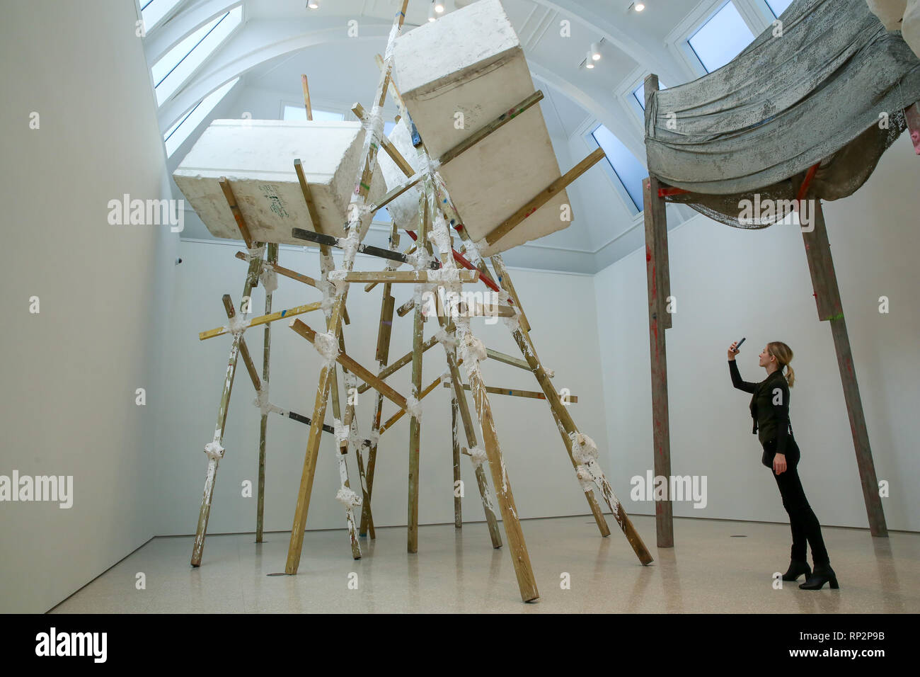 London, UK. 20th Feb, 2019. A woman is seen taking photos of Phyllida Barlow's installation at the Royal Academy of Arts in London.British artist Phyllida Barlow transforms the Royal Academy's Gabrielle Jungels-Winkler Galleries with an exhibition of entirely new work, entitled cul-de-sac. The exhibition has been conceived as a sequential installation running across all three of the interconnected spaces. The exhibition is open to the public from 23 February until 23 June 2019. Credit: Dinendra Haria/SOPA Images/ZUMA Wire/Alamy Live News Stock Photo