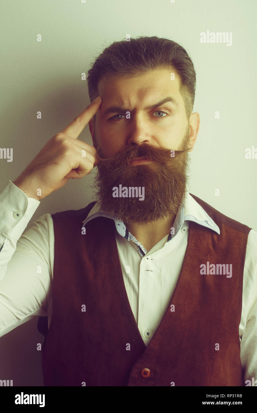 bearded man, brutal caucasian hipster with serious face - Stock Image