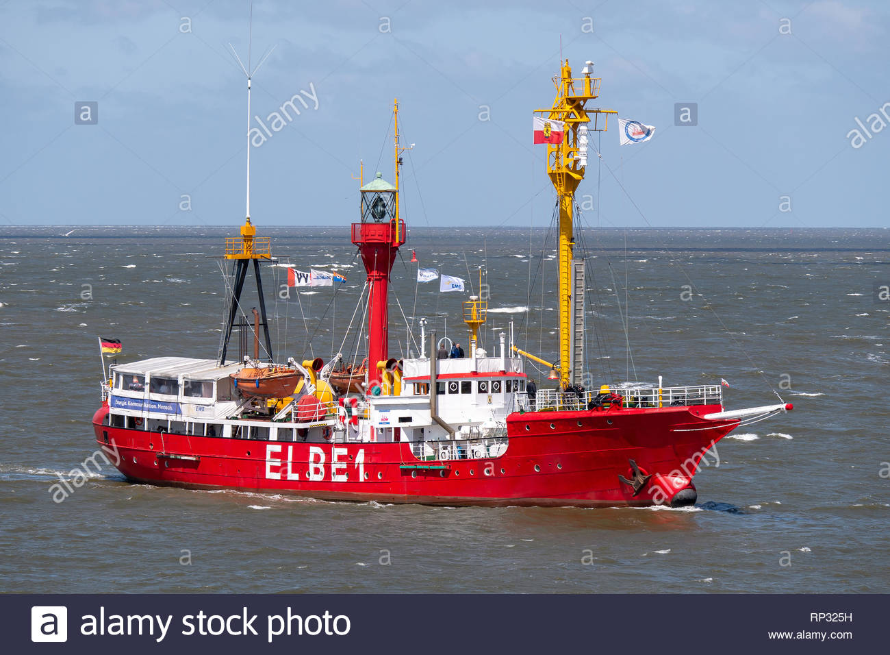 The lightvessel ELBE 1 BÜRGERMEISTER OSWALD sailing on the Elbe river passing Cuxhaven - Stock Image