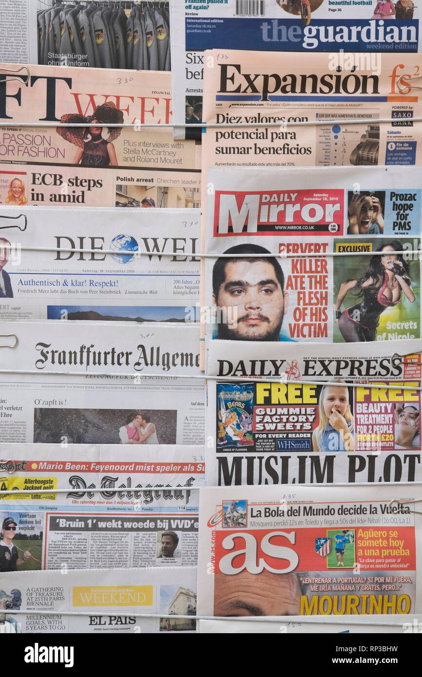 English and foreign language newspapers at a outdoor newsstand Stock Photo