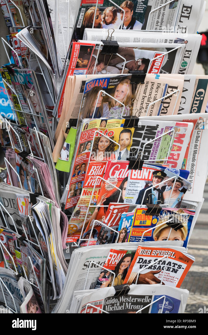 English and foreign language newspapers and magazines at a outdoor newsstand Stock Photo