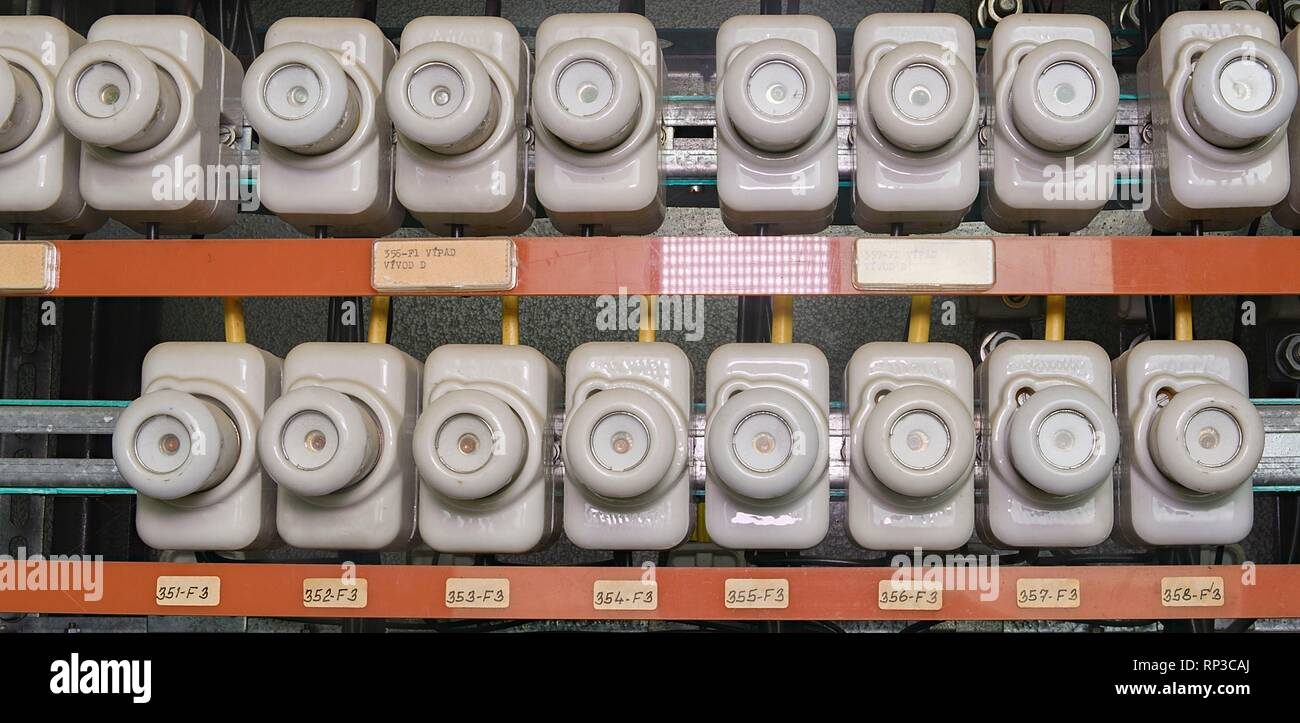 old electrical fuse box with porcelain fuses  - stock image