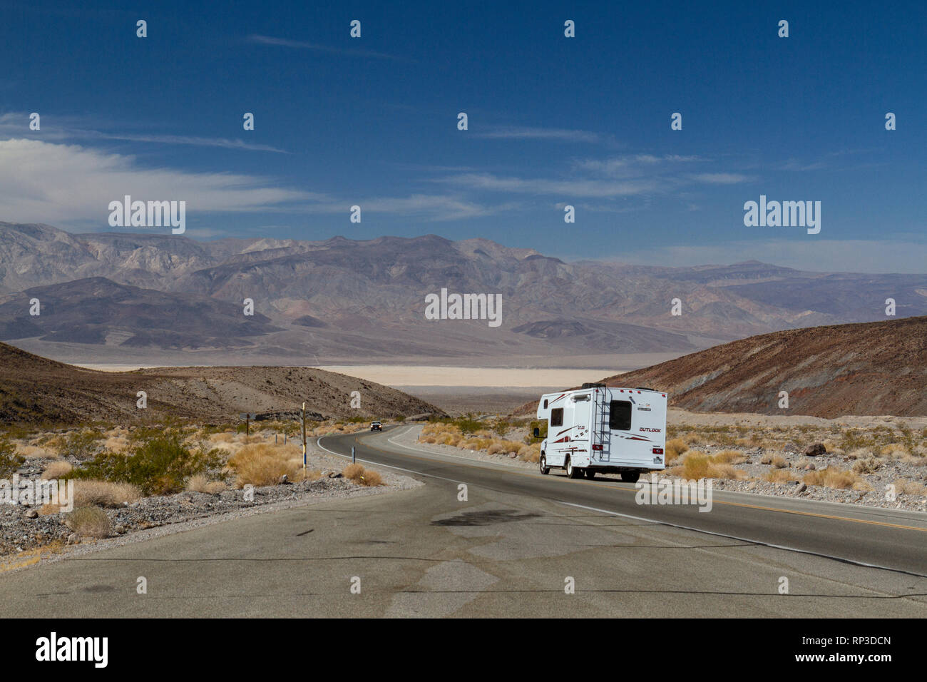 Camper van on California State Route 190 heading towards Panamint Springs, Death Valley National Park, California, United States. Stock Photo