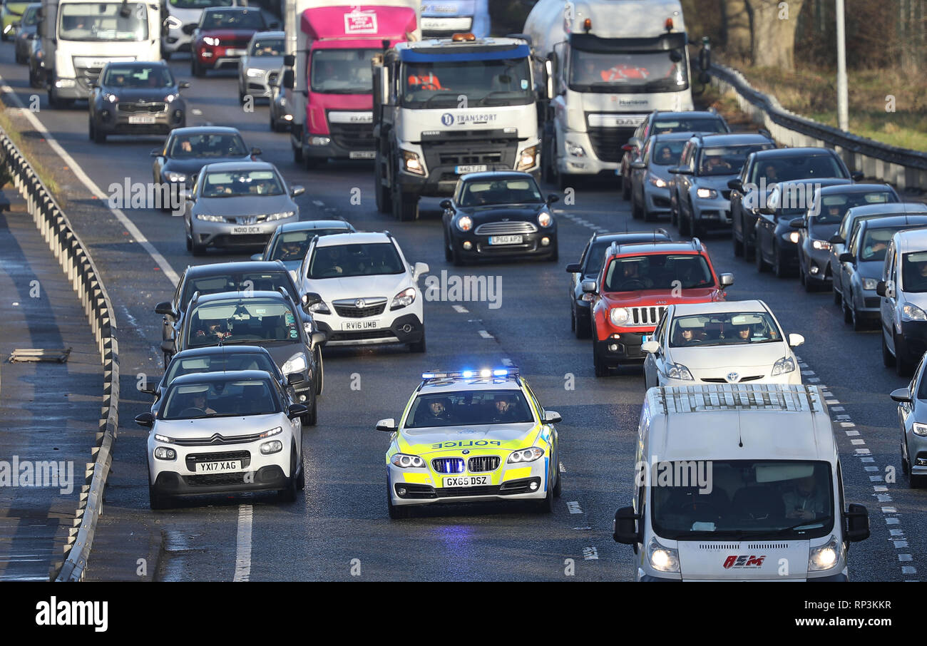 Motorists move out the way of a Sussex Police Car with its Blue lights flashing and siren sounding as it drives down the A23 near Brighton, East Sussex Stock Photo