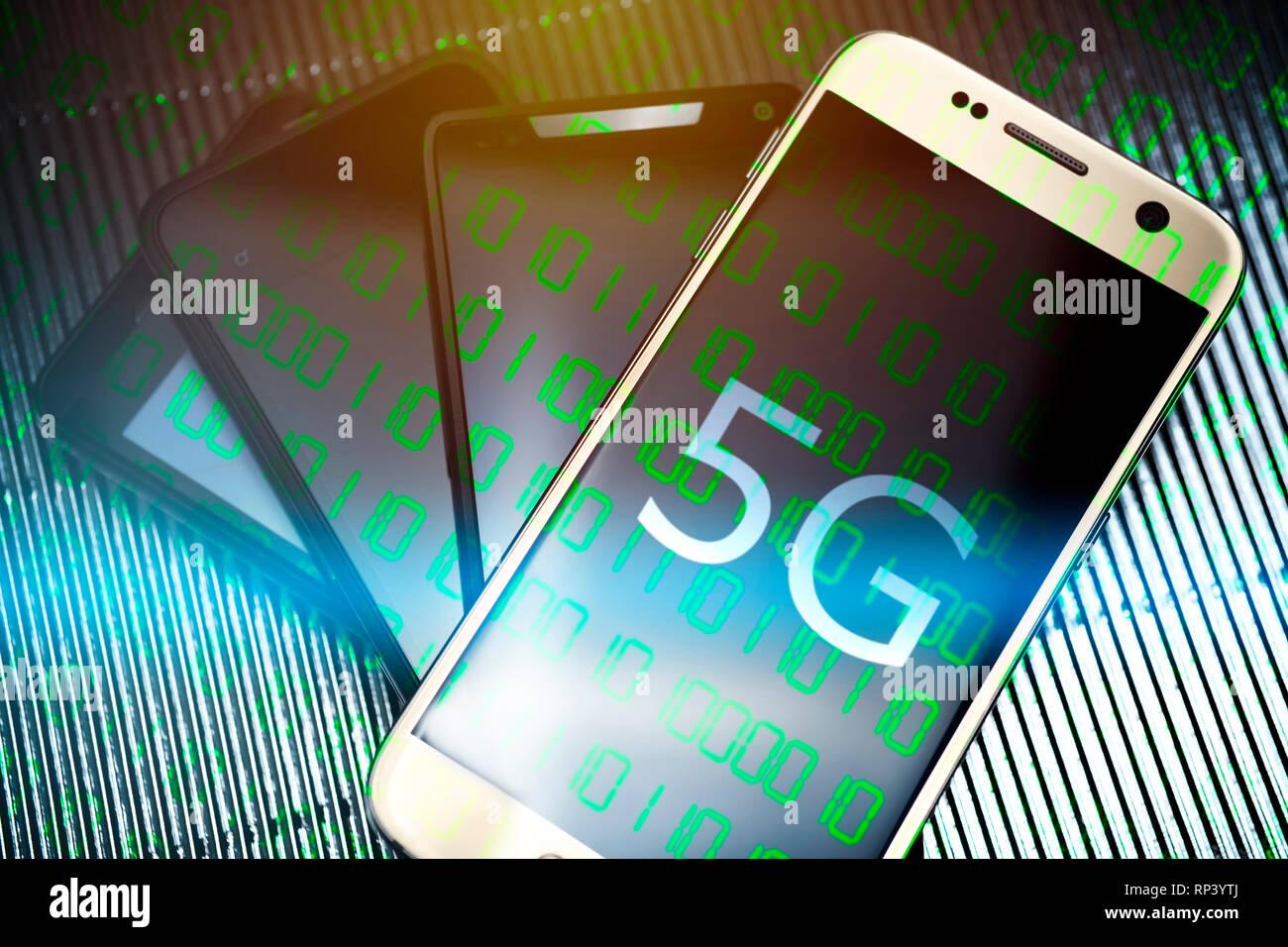Smartphones with the label 5 g, 5G-net, Smartphones mit der Aufschrift 5G, 5G-Netz Stock Photo