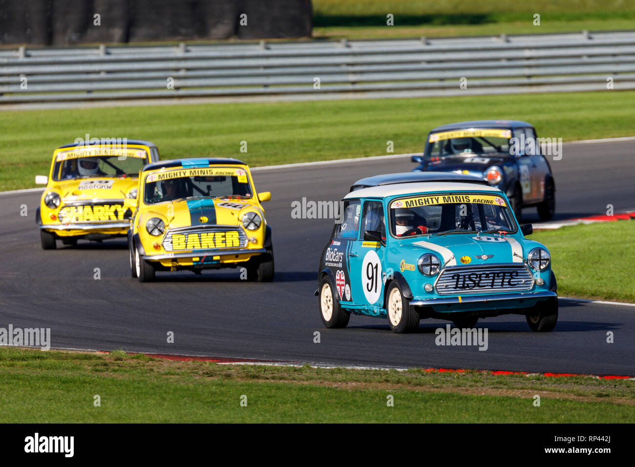 Lisette Ogborn leads the Mighty Minis through Palmer at the Snetterton 2018 Championship meeting, Norfolk, UK. - Stock Image