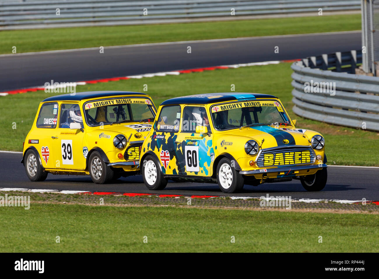 Matthew Baker and Mark Davies battle it out in the Mighty Minis Championship race at Snetterton 2018, Norfolk, UK. - Stock Image