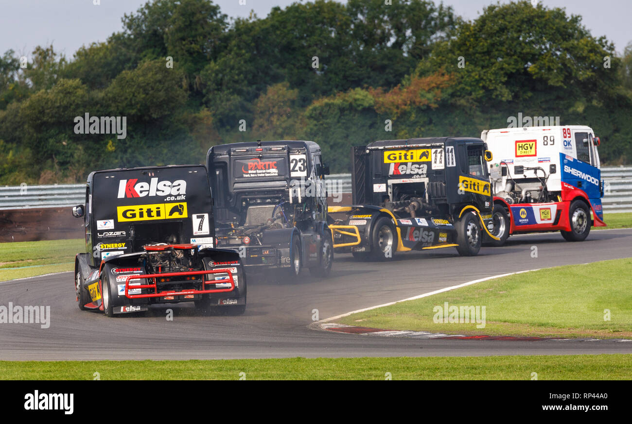 Simon Reid, Martin Gibson, Jamie Anderson and Stuart Oliver head through Oggies at the Snetterton 2018 Division 1 Truck Racing event, Norfolk, UK. - Stock Image