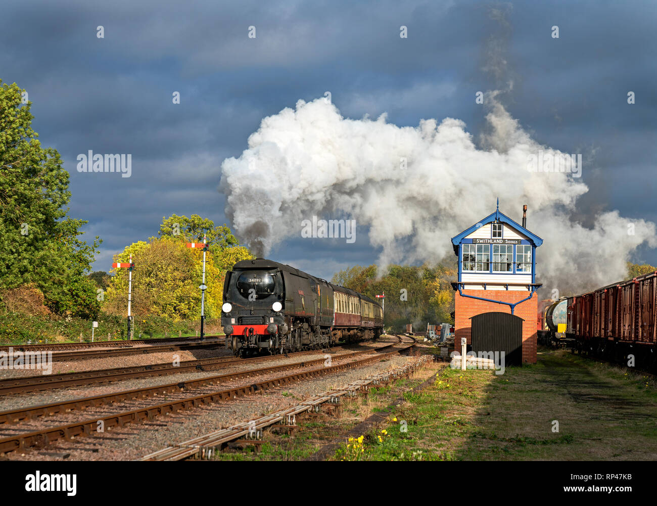 WC-Class Pacific steam locomotive No. 34092 City of Wells passing Swithland Sidings signal box en route from Loughborough to Leicester on the Great Ce - Stock Image
